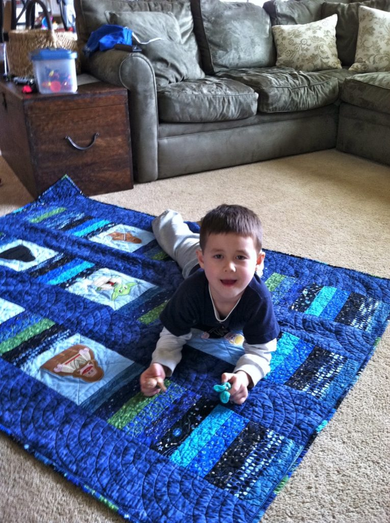 Jake enjoying his Star Wars quilt