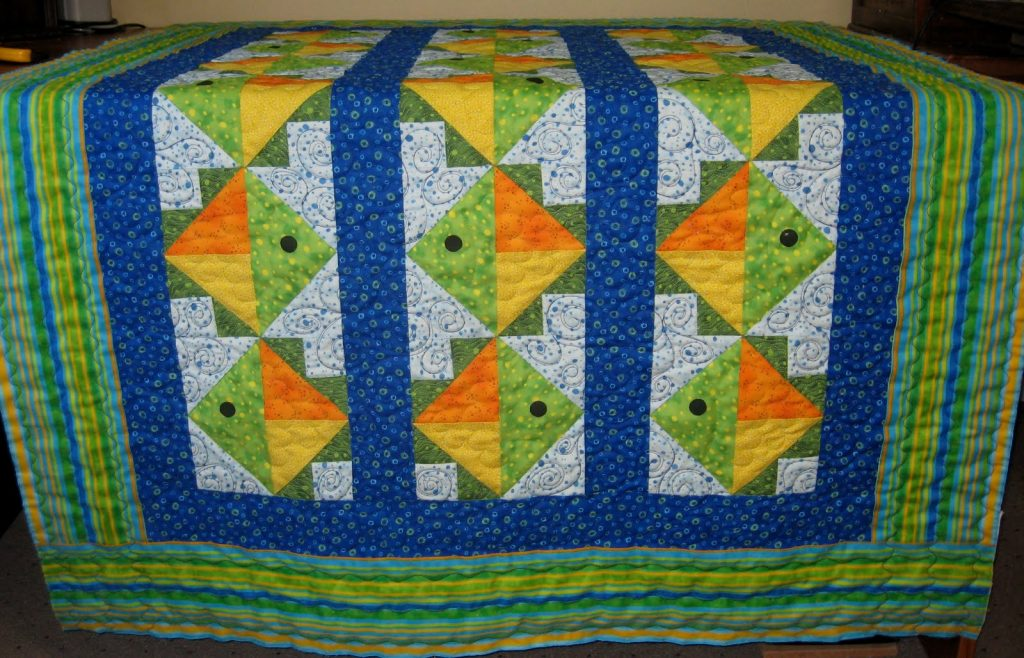 Flying Fish Quilt by Jean Ann Wright, Fish quilt at the longarmers
