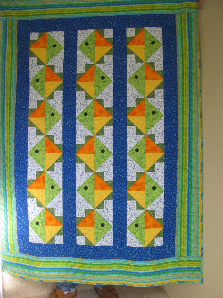 Flying Fish Quilt by Jean Ann Wright, Finished quilt with light background