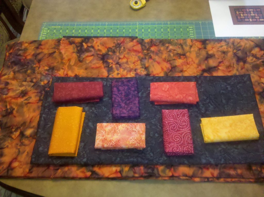 Auditioning Fabrics for Charming Fractions quilt by Kari Nichols, Mountainpeek Creations