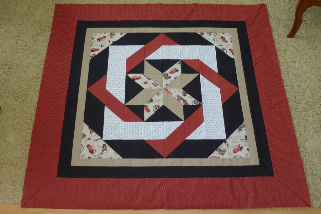 Labyrinth by Debbie Maddy of Calico Carriage Quilt Designs, Quilt top - showed mitered corners
