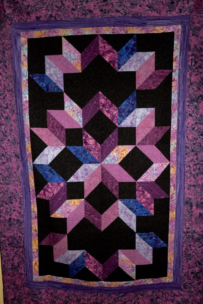 Cosmic Jewels (carpenter star), Ron's finished quilt
