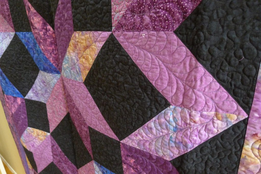 Cosmic Jewels (carpenter star), Quilting detail shows stippling