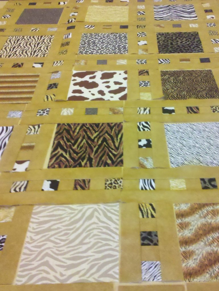 Slide Show quilt pattern by Terry Atkinson of Atkinson Designs, Animal print block layout