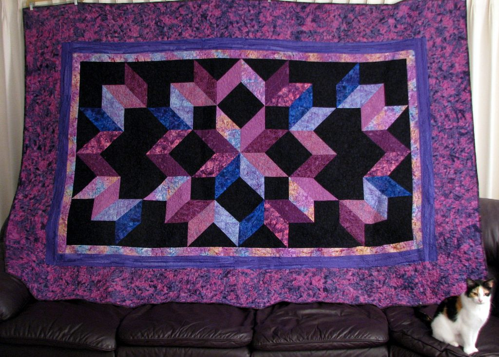 Cosmic Jewels (carpenter star), Ron's quilt with Muffin
