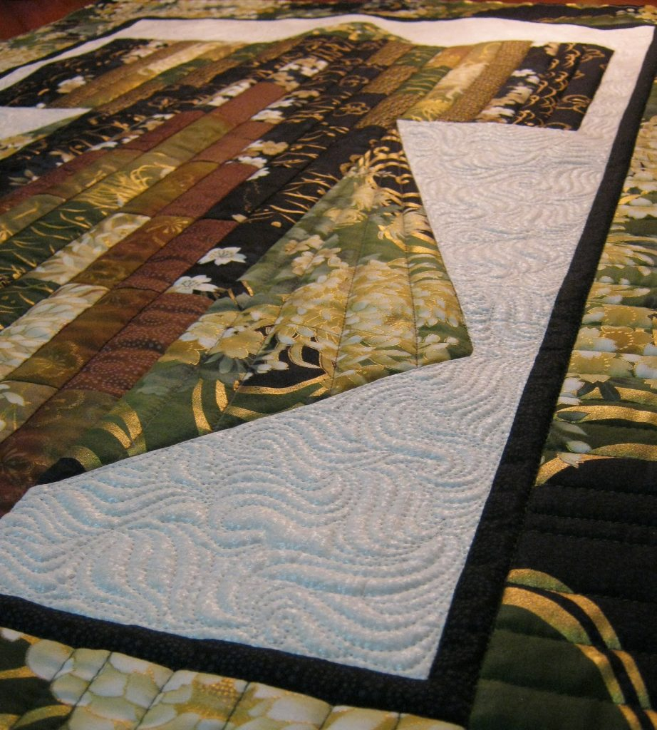 Bargello Kimono quilt by Diane McGregor of Castilleja Cotton, Quilted top - piano key border detail