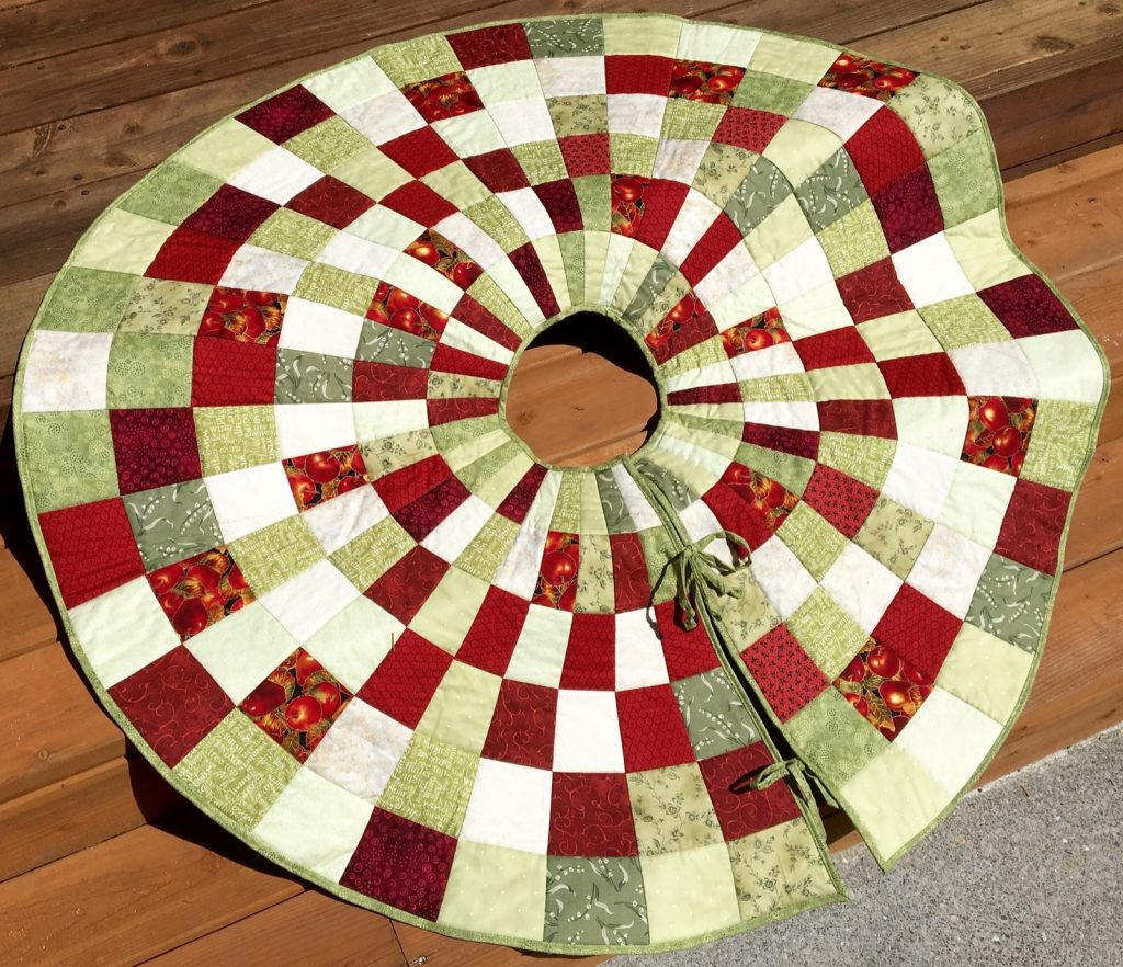 Quilted Christmas tree skirt, Finished scrappy skirt front