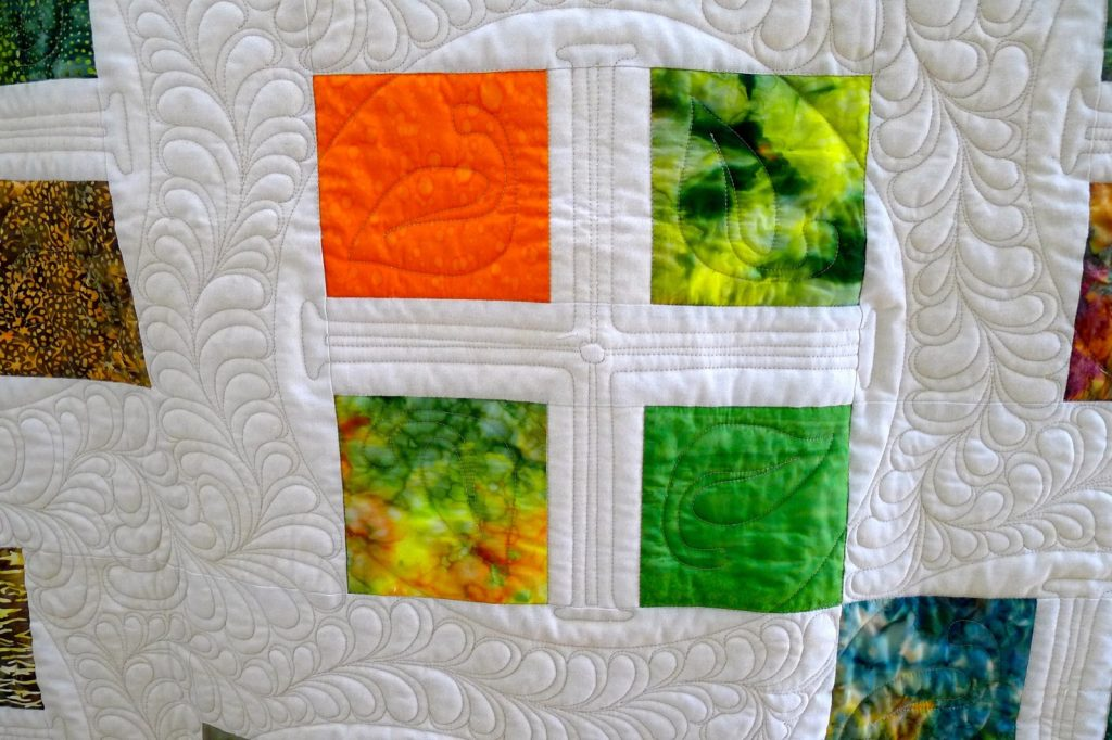 Square Dance quilt pattern by Konda Luckau, Finished quilt closeup 1