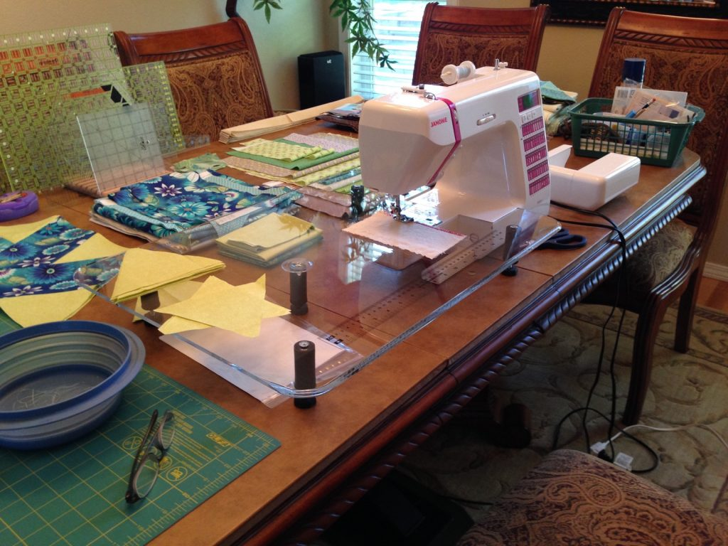 Sewing machine setup on the dining room table