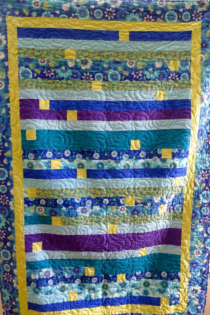 Finished jelly roll race quilt