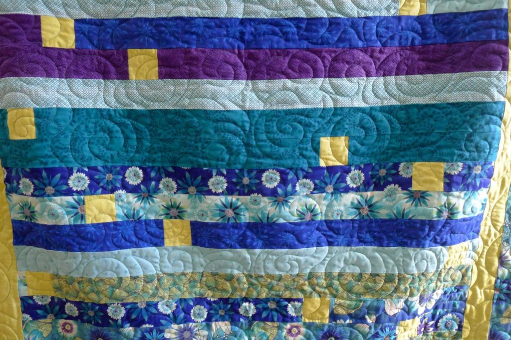 Finished jelly roll race quilt detail