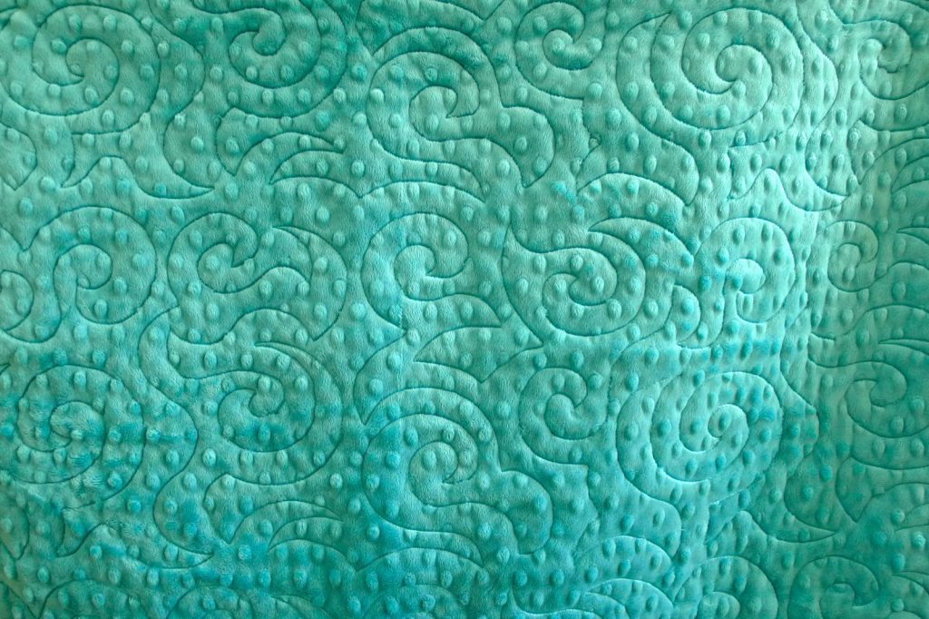 Finished jelly roll race quilt back detail