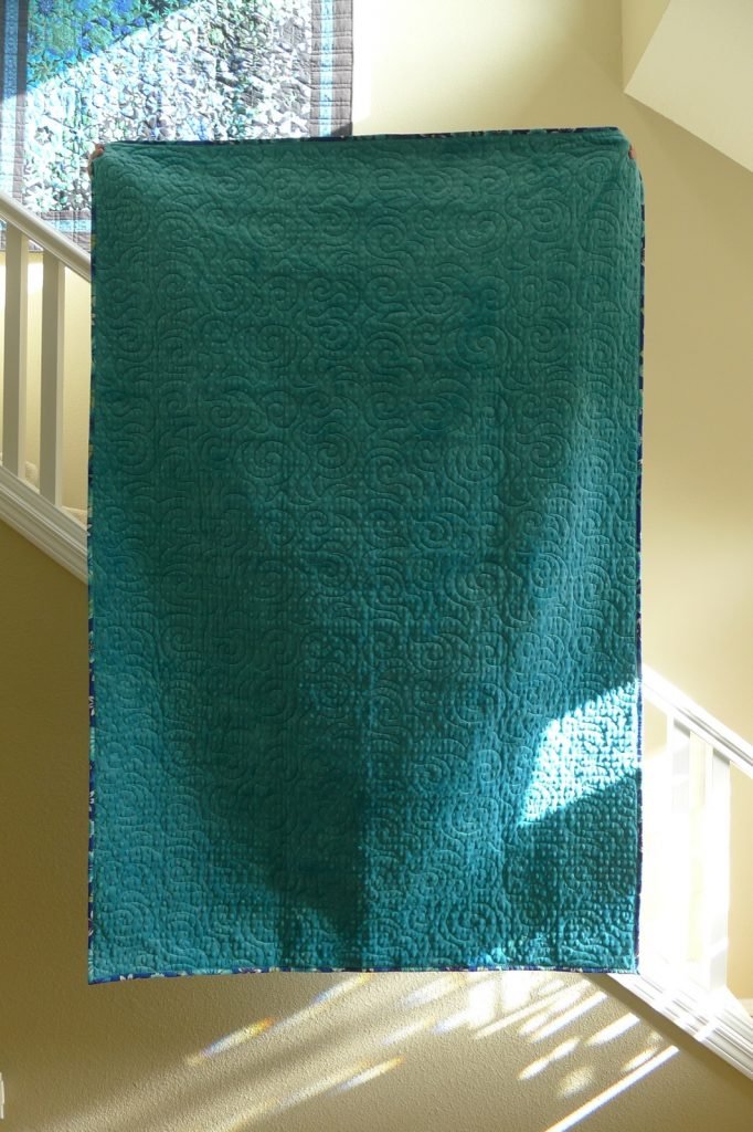Finished jelly roll race quilt back