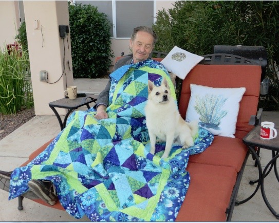Equilateral triangle quilt, Quilt being enjoyed by DeAnn's S.O. George, and pup