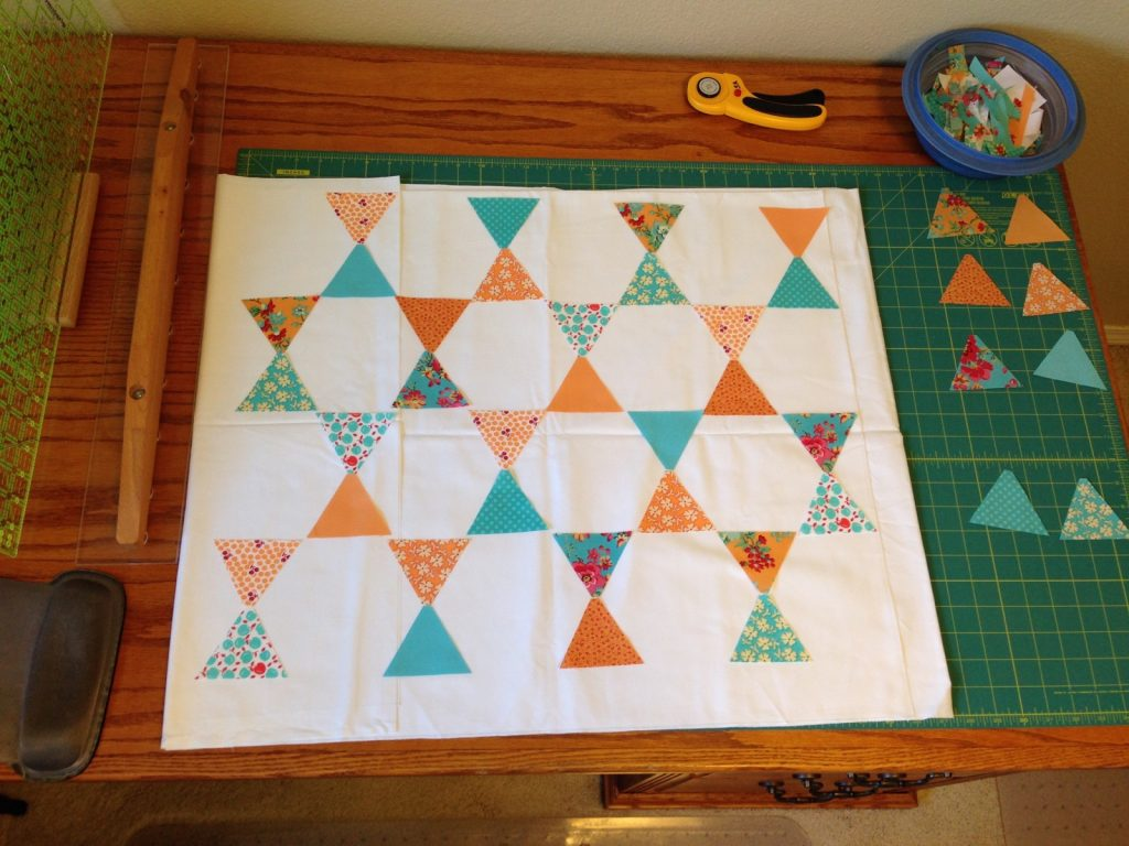 Laying out apricot and aqua Candy Dish pillow fronts by Jaybird