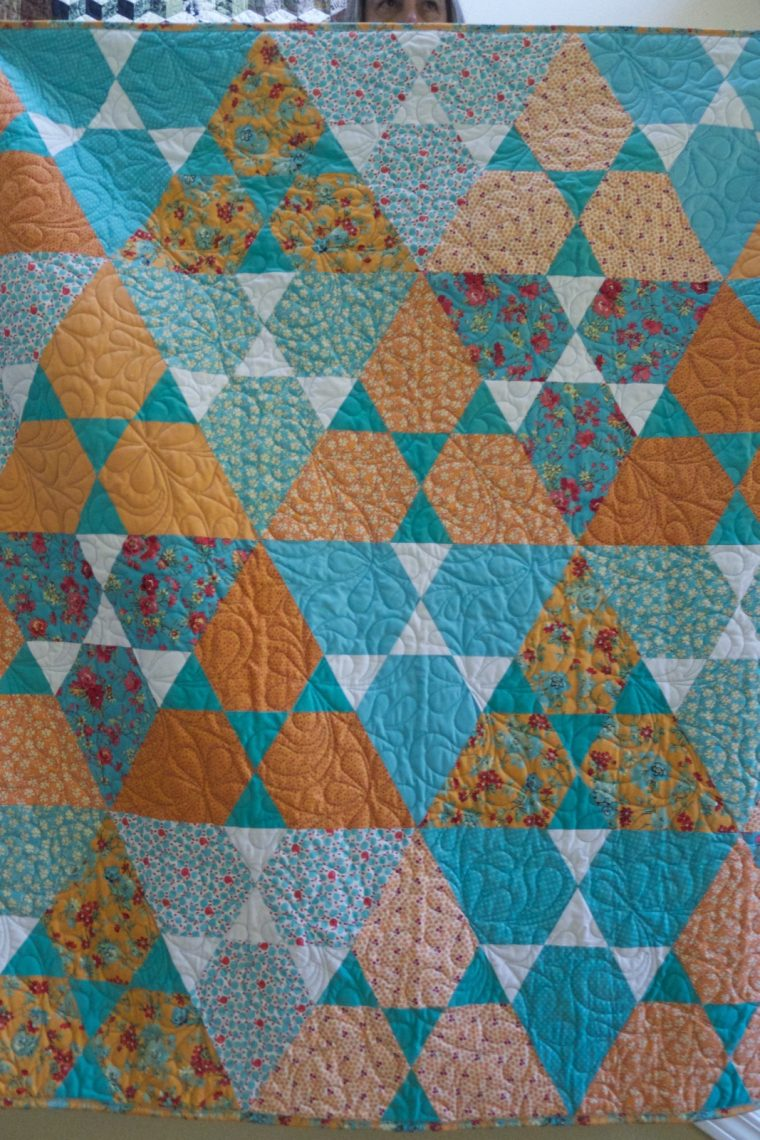 Finished apricot and aqua Lotus quilt by Jaybird