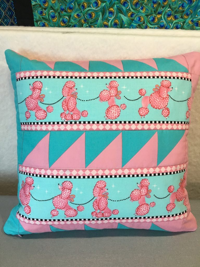 Finished pink poodle pillow front