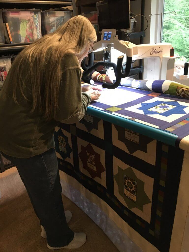 Doing ruler work on my National Park quilt