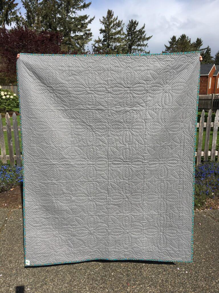 Disappearing hourglass quilt back
